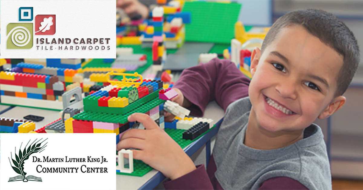 Child playing with legos with Island Carpet and Martin Luther King Jr. Community Center logos in the corner